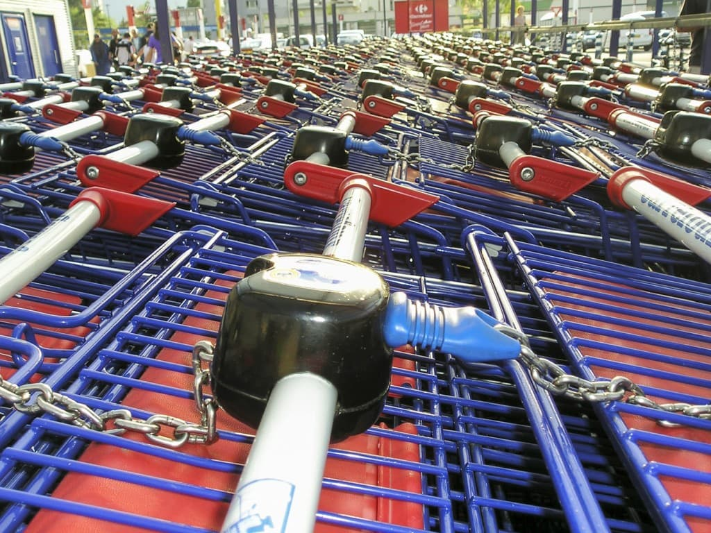 """Shopping carts at the """"Carrefour"""" Supermarket in Grenoble, France"""