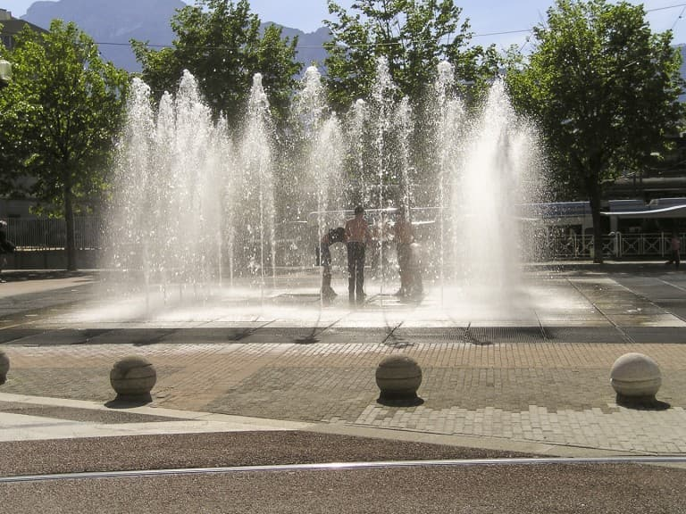 Youth took advantage of the beautiful spring days to play and bathe in the fountain in Grenoble, France
