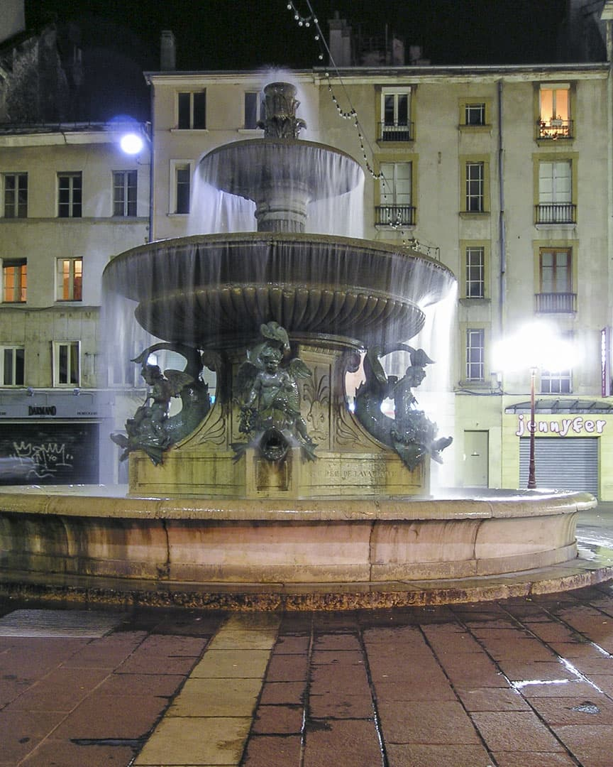 """Fountain by night at the """"Grenette"""" square in Grenoble, France"""