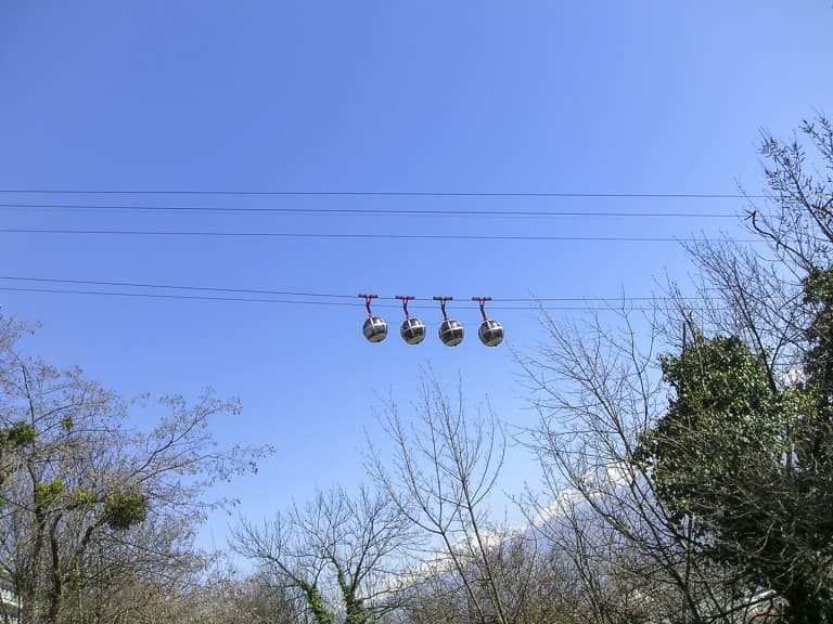 "Bubble styled cable cars, running between the city and the mountain fortress ""La Bastille"" in Grenoble, France"