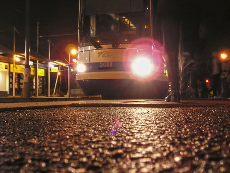 Tram at the stop by night in Grenoble, France