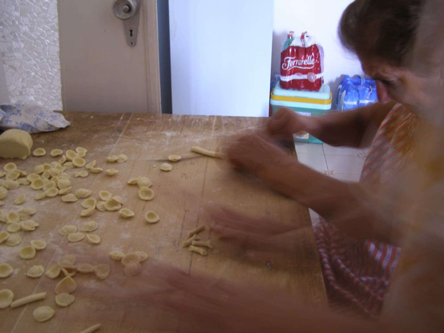 Old ladies are making hand-made pasta.