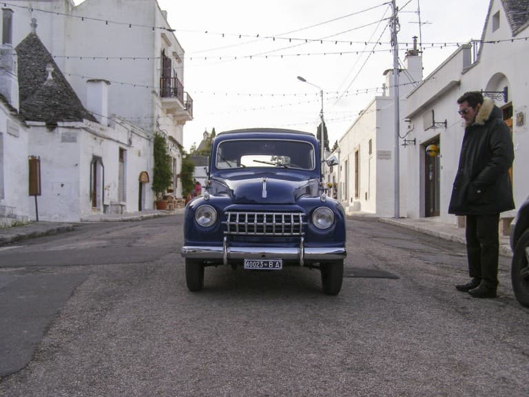 An old Italian car on the road at Ostuni in Puglia