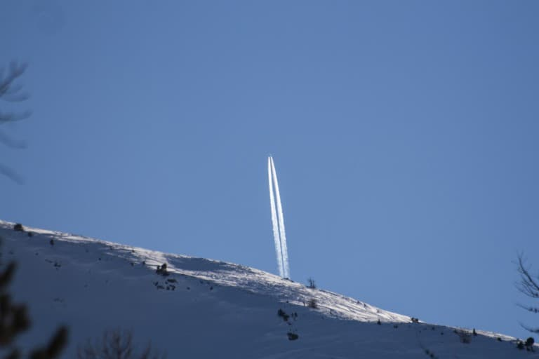 A plane check from the mountain leaving contrails