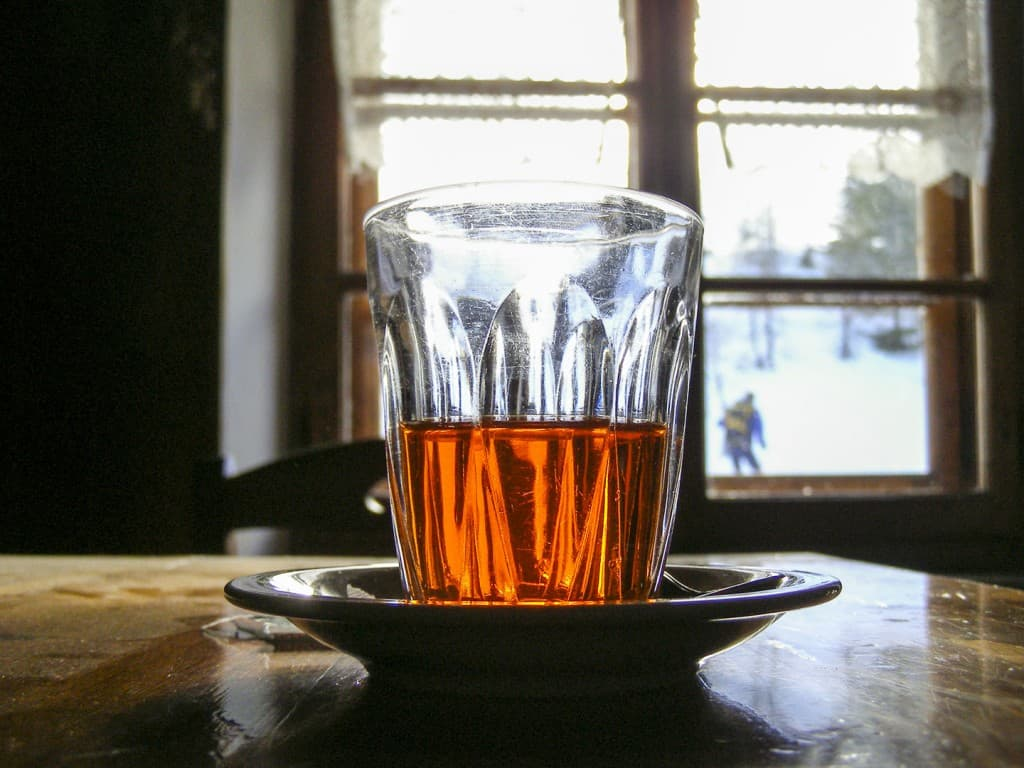 A glass with Punsch liquor on the table of the refuge