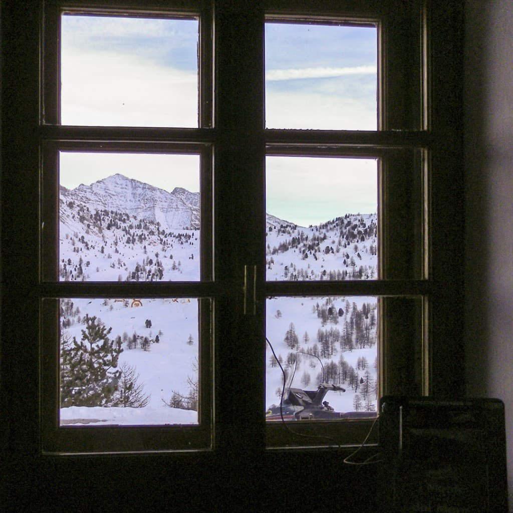 View of the Alps from the window of the refuge on the Black Lake