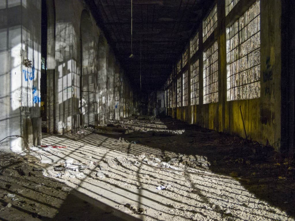 Shadow Cage at the Abandoned Train Repairing Workshop in Turin, Italy