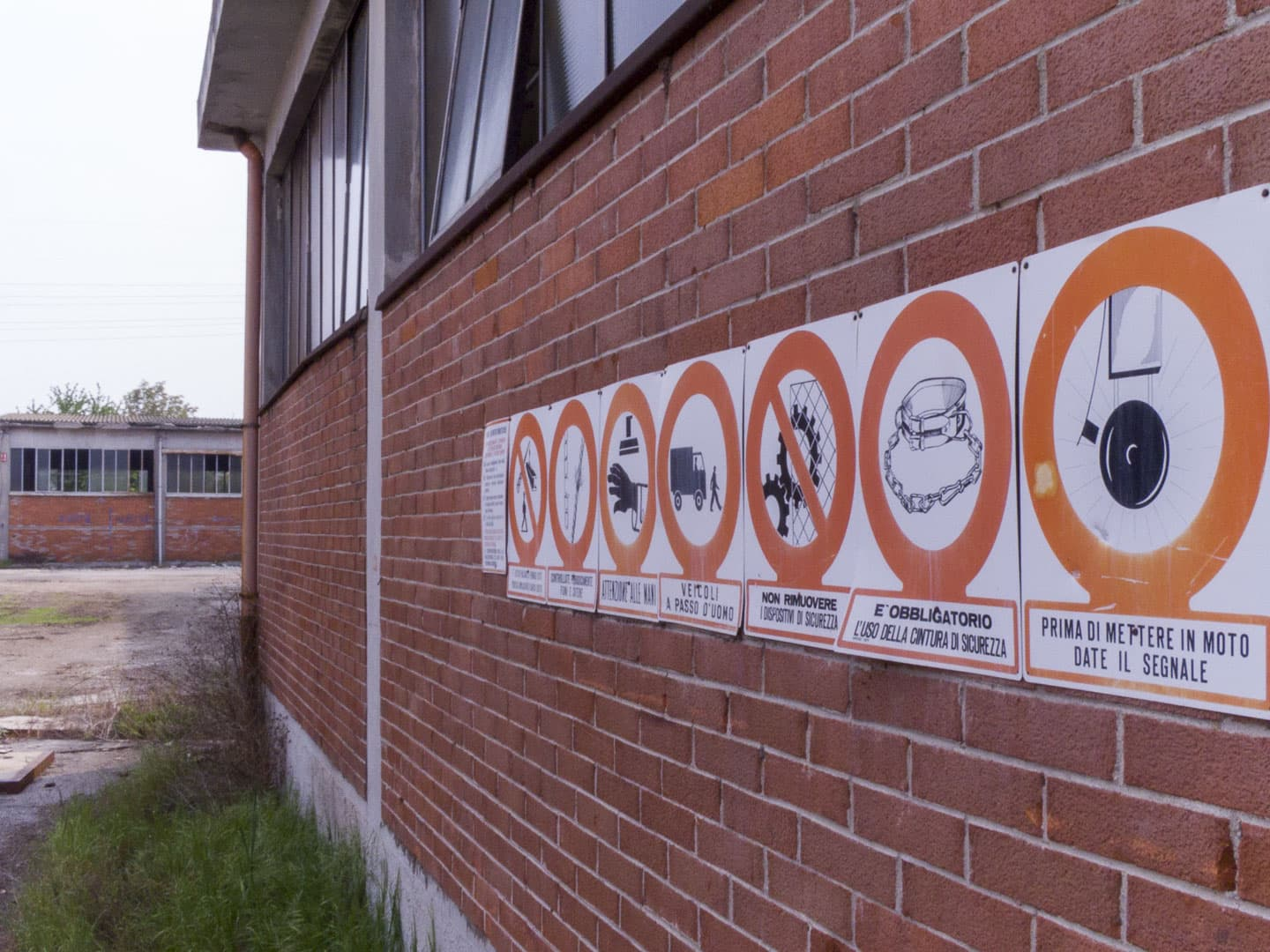 Warning Signs at Unknown Abandoned Factory in Nichelino, Italy