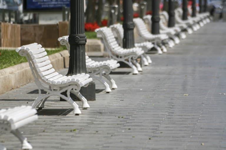 White benches lined at the Rambla Nova in Tarragona