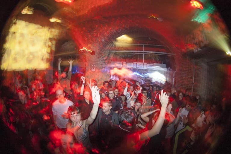 People Dancing at Drum and Bass DJ Set by ARPX at Puddhu Bar in Turin, Italy