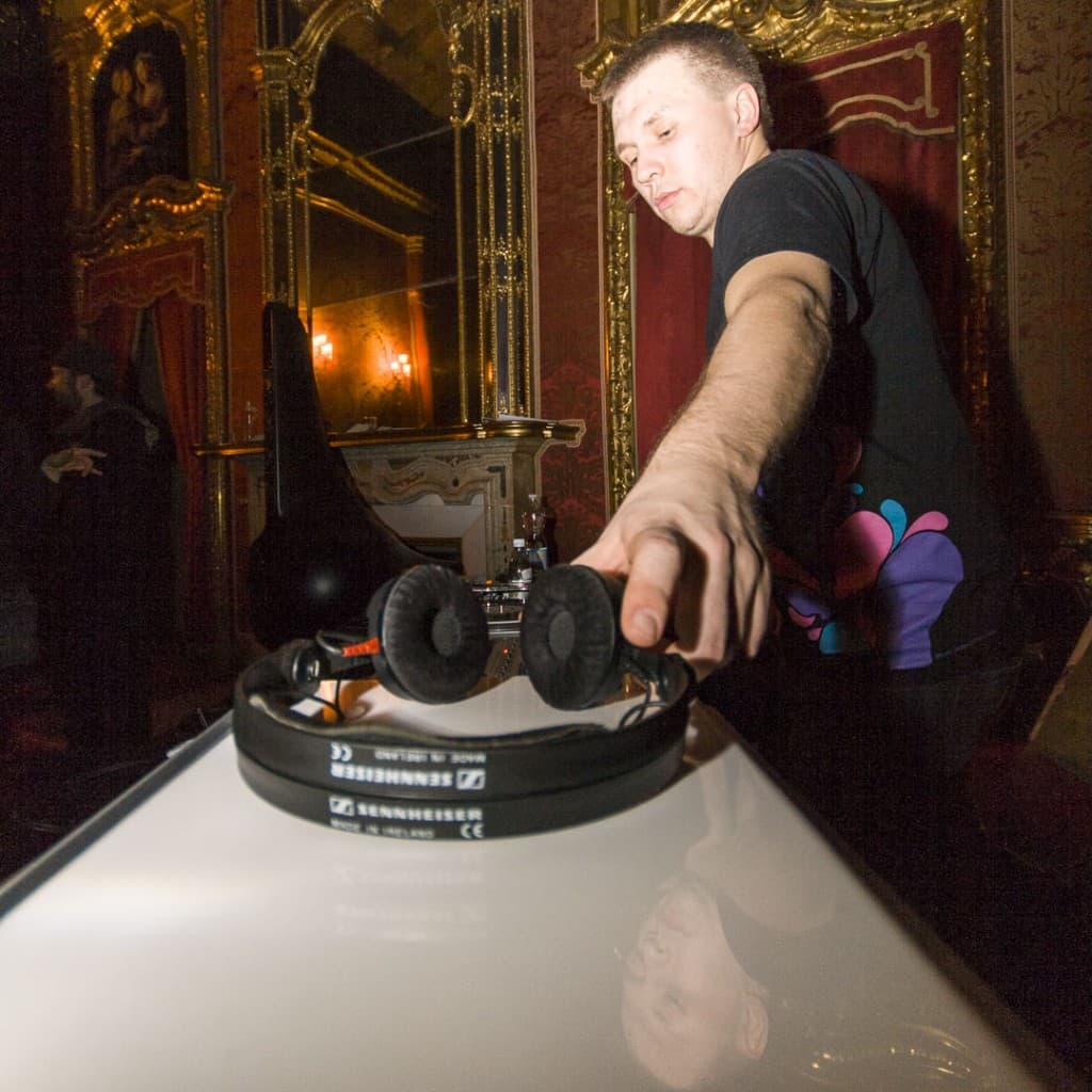 Andrey Pushkarev picking up headphones at Palazzo Saluzzo Paesana in Turin, Italy