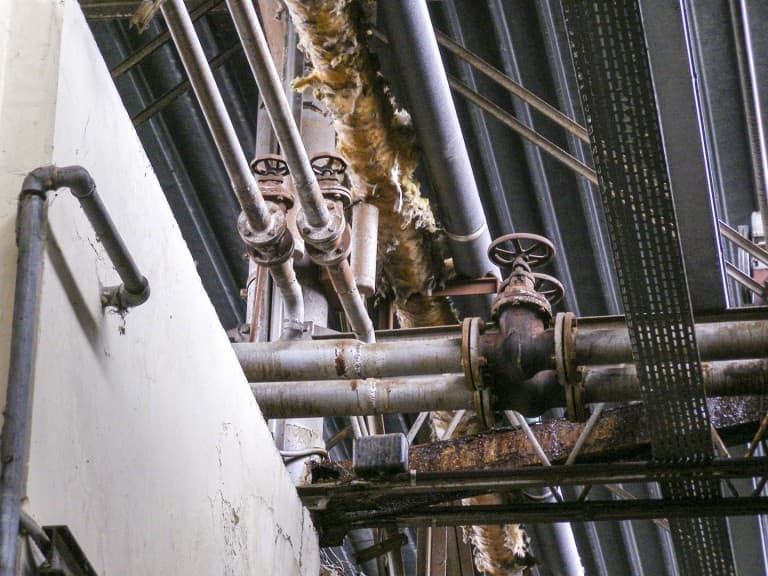 Tubes at Abandoned Construction Equipment Vehicles Factory in Turin