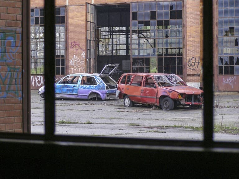 Cars at Abandoned Construction Equipment Vehicles Factory in Turin