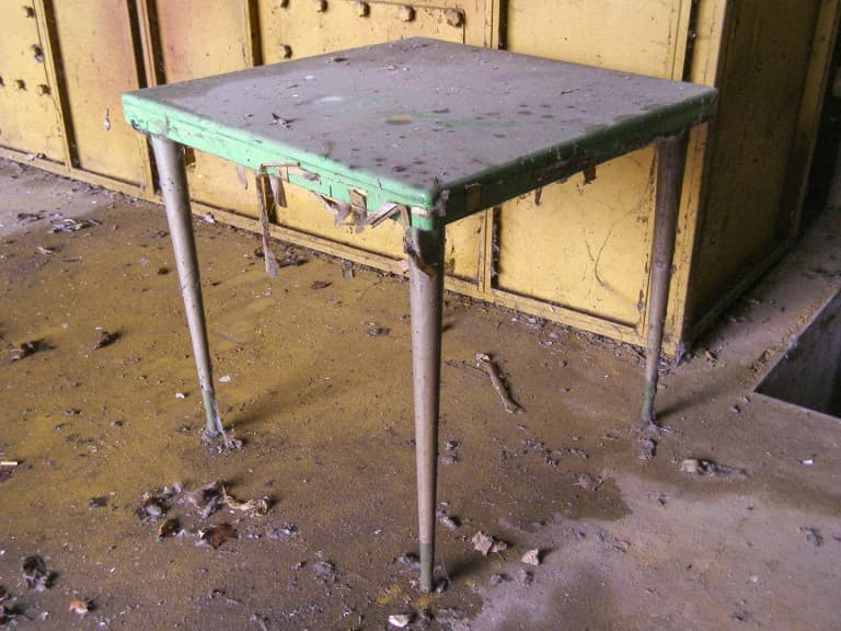 Table at Abandoned Construction Equipment Vehicles Factory in Turin