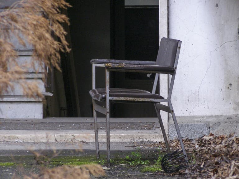 Chair at Abandoned Construction Equipment Vehicles Factory in Turin