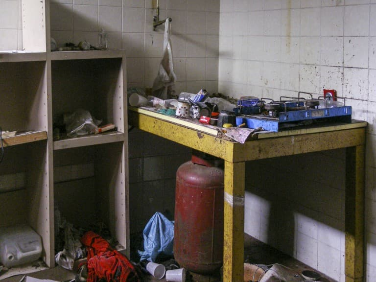 Kitchen at Abandoned Construction Equipment Vehicles Factory in Turin