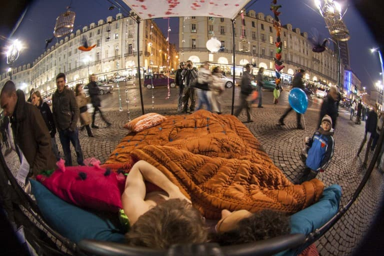 Copy in the bed performance on Piazza Castello – Turin, Italy