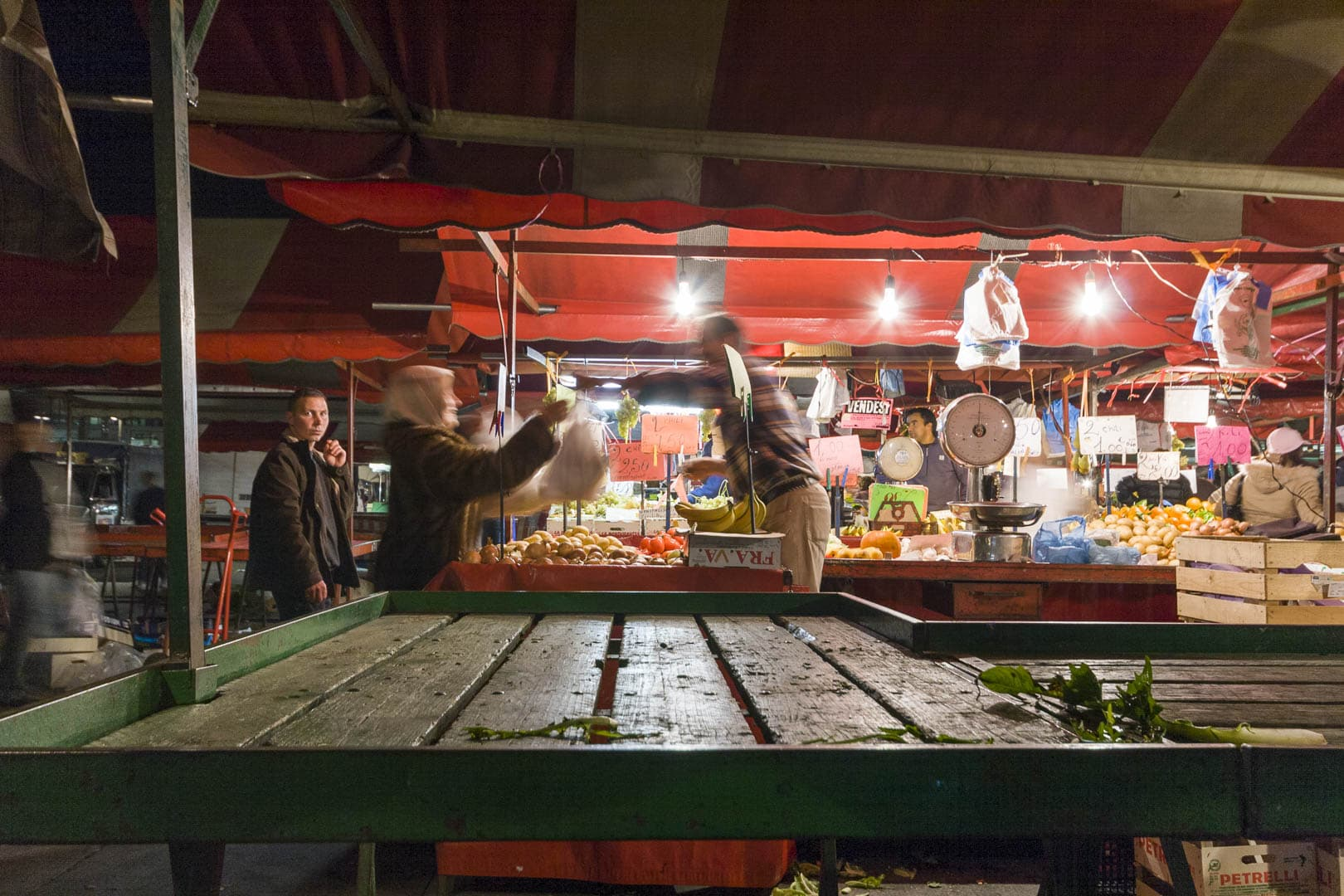 Seller at the Porta Palazzo night market – Turin, Italy